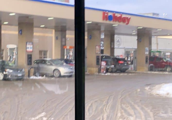 Holiday gas station carjacking