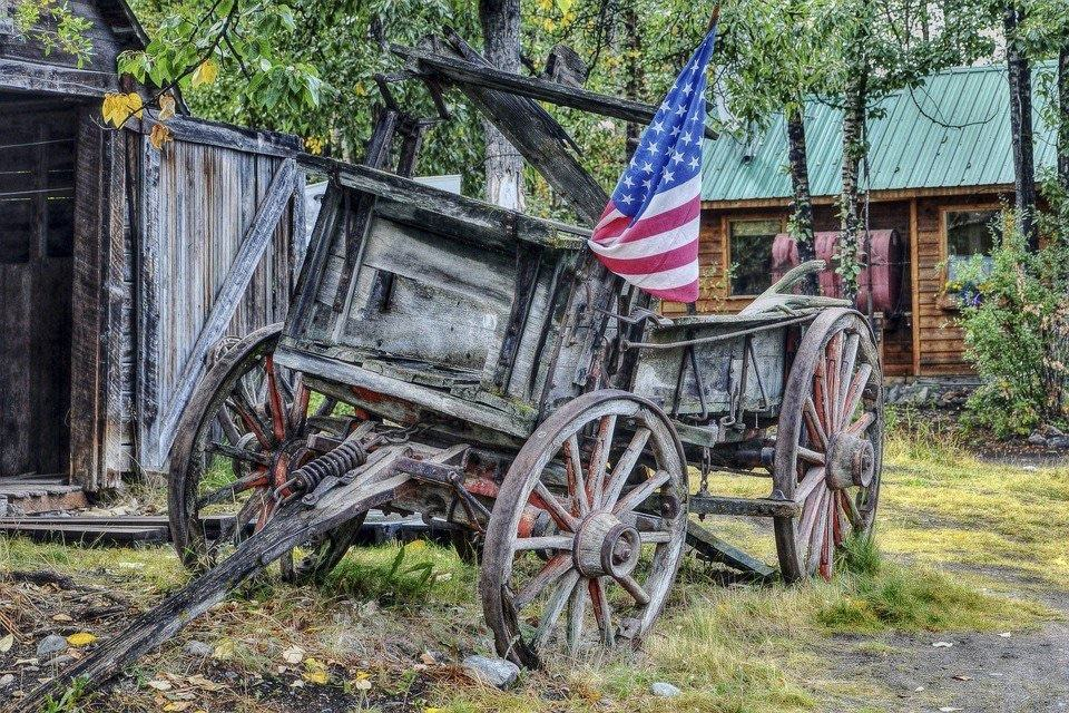 About: Old wooden wagon with American flag
