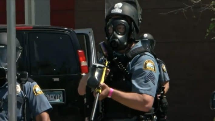 shows a St. Paul police officer in riot gear